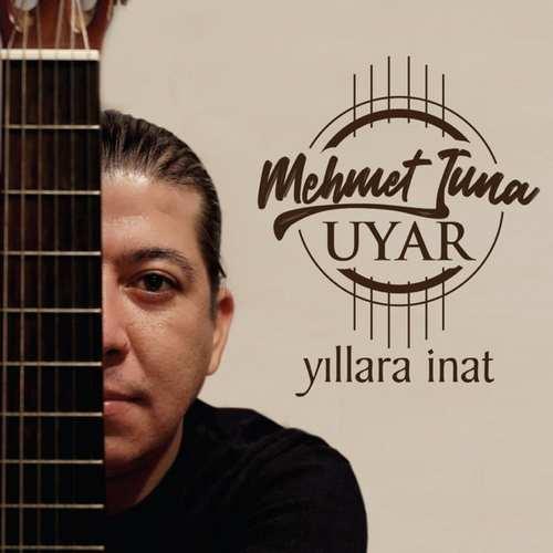 Mehmet Tuna Uyar Yeni Yıllara Inat Şarkısını İndir